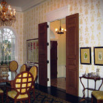 We emphasized this grandeur with a large scale yellow and white pineapple wallpaper.