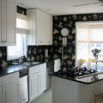 Black background wallpaper adds depth and interest to this cheerful kitchen