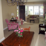 Picture perfect living/dining room in exquisite pink and green fabrics