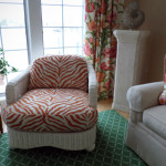 The chairs are done in an orange zebra pattern chenille.